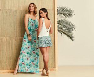 Duas mulheres, uma com vestido longo outra com shorts de alfaiataria 02.