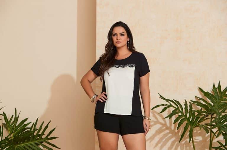 Modelo com cores verão 2020: blusa preta/branca e short preto